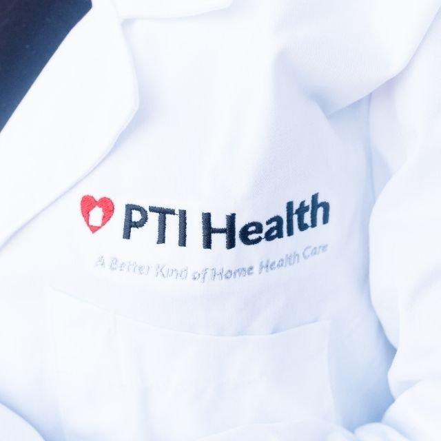 White PTI Health lab coat
